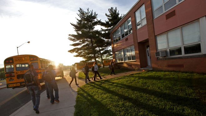 Students enter Christiana High School in this News Journal file photo.