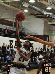 Abilene High's Trakenya Roberson goes up for a layup