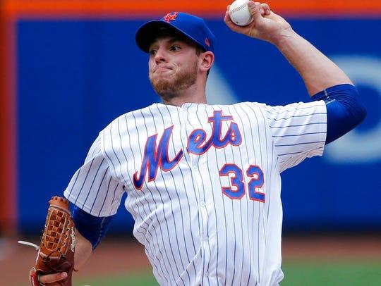 New York Mets starting pitcher Steven Matz (32) winds