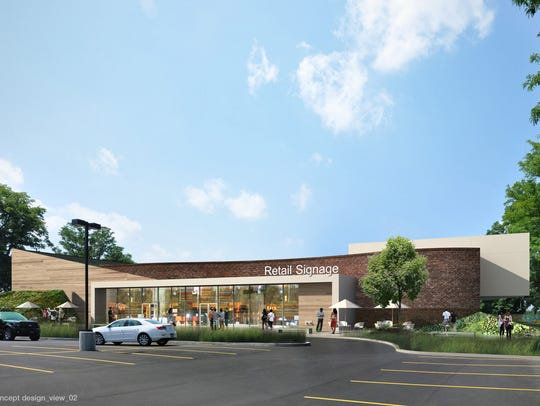 A new retail building replaces the once-planned, five-story