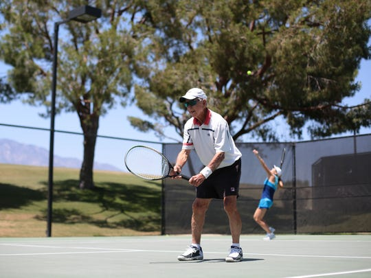 91-year-old tennis player Graydon Nichols, a 58-time national champion plays double with his daughter Eileen Christin on Thursday, May 5, 2016 at The Club at Morningside in Rancho Mirage. The pair with compete in the USTA Father's/Daughter's tournament this weekend.