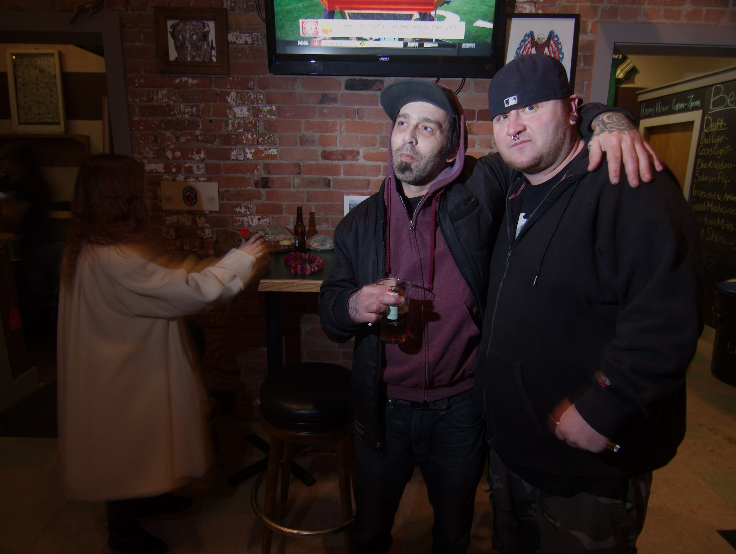 Aaron Hicks and friend enjoy drinks at the Back Alley