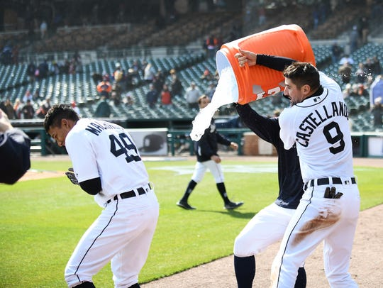 Tigers' Nick Castellanos douses DIxon Machado during