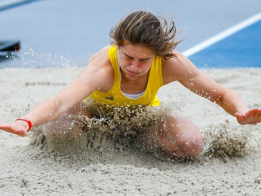 Iowa City West High's Valerie Welch competes in the