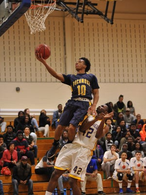 Pocomoke's Tyler Nixon with the lay up after a turn over the game against Wi-Hi on Thursday, December 10. at Wicomico High School.