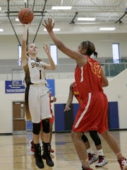 Roger Bacon's Kaylee Sunders drives to the basket against