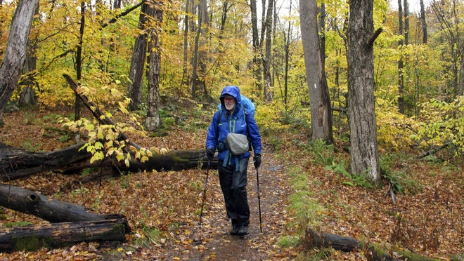 Artist Rob Mullen walks down Long Trail, the country's oldest long distance trail,Tuesday in Manchester, Vt.