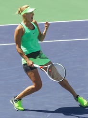 Elena Vesnina celebrates a point win over Svetlana