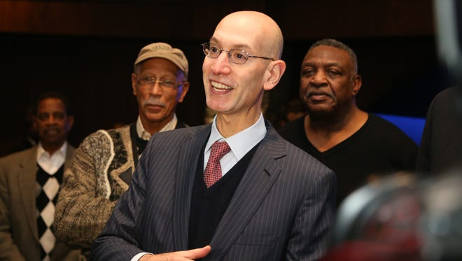 NBA commissioner Adam Silver talks with mentors before the Pistons played the Bulls at the Palace on Monday.