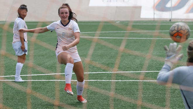 UTEP soccer forward Vic Bohdan attempts a kick on goal during the 9th Annual Media Day PK Challenge. Bohdan is looking forward to continuing her mark as one of the teams top goal scorers once again.