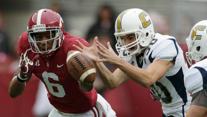Alabama defensive back Ha Ha Clinton-Dix (6) and Chattanooga kicker Nick Pollard (30) chase a blocked field goal attempt during the first half of an NCAA college football game in Tuscaloosa, Ala., Saturday, Nov. 23, 2013. Alabama defensive lineman A'Shawn Robinson (86) blocked the field goal and Alabama recovered. (AP Photo/Dave Martin) ORG XMIT: aldm105