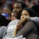 Meek Mill and Nicki Minaj watch  an NBA basketball game between the Portland Trail Blazers and the Philadelphia 76ers, Saturday, Jan. 16 in Philadelphia.