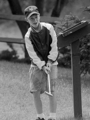 Brian Patane, age 9, from Webster, playing miniature golf at Rinky Dink on Panorama Trail on Aug. 15, 1994.