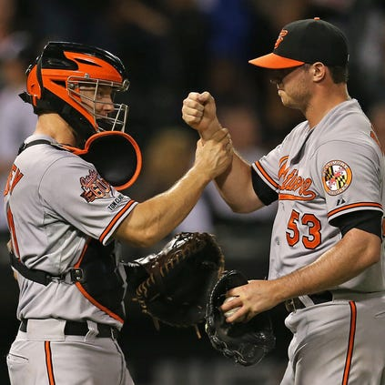 CHICAGO, IL - AUGUST 20: Nick Hundley #40 (L) and Zach Britton #53 of the Baltimore Orioles celebrate a win against the Chicago White Sox at U.S. Cellular Field on August 20, 2014 in Chicago, Illinois. The Orioles defeated the White Sox 4-3.  (Photo by Jonathan Daniel/Getty Images)
