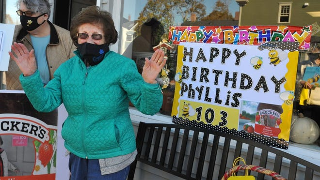 Phyllis Chapman of Hingham thanks her Hingham Senior Center exercise classmates for surprising her on her 103rd birthday as she was having her done at the Station 27 salon in Hingham, Thursday, Nov. 5, 2020. Tom Gorman/For The Patriot Ledger