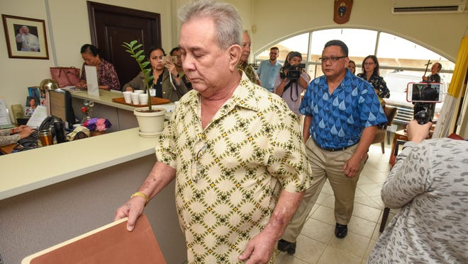 Attorney David Lujan, front, walks with his client Roland Sondia, as the two prepare to meet behind closed doors with Vatican tribunal members at the Archdiocese of Agana chancery office in Hagatna on Thursday, Feb. 16, 2017. Sondia alleges being sexually assaulted by Archbishop Anthony Apuron in the 1970s when he served as an altar boy with Apuron at a church in Agat.
