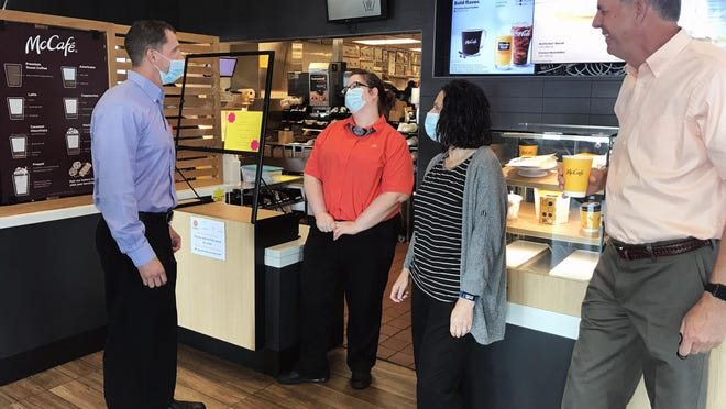Brian Gremaud, from left, general manager Sarah McDaniel, supervisor Janet Miller and Mike Gremaud visit at the front desk of the McDonald's in Grain Valley. Mike has been in the business for 49 years and his son Brian recently became an operator in the McDonald's franchise. They collectively own nine McDonald's restaurants, including the franchises in Grain Valley and Oak Grove.