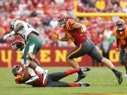 Iowa Statedefensive back DÕAndre Payne takes down Baylor running back Terence Williams as Iowa State defensive end Mitchell Meyers (58) comes in to assist Saturday, Oct. 1, 2016 at at Jack Trice Stadium in Ames.