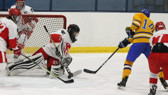 North Rockland goalie Angelo Zodda steers aside a shot