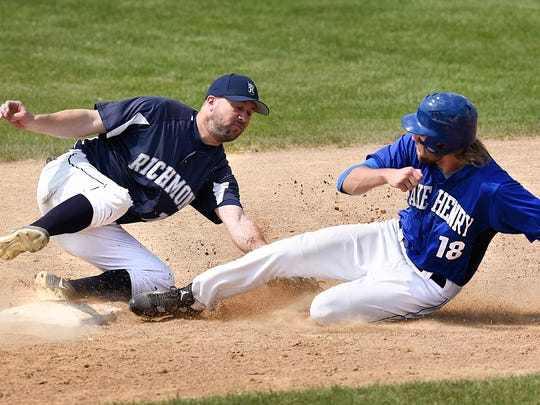 Richmond's Brent Ruegemer, left, can's get the tag