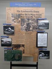 Rod Edmondson, grandson of  crash victim Kenneth Edmondson, put together a board of memorabilia for the 50th anniversary of the plane crash that killed five area residents.
