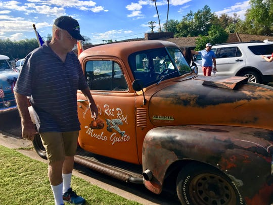 Bob Mason walks next to his rebuilt 1951 Chevrolet