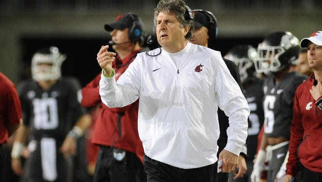 Washington State coach Mike Leach watches his team during its win against Southern California.
