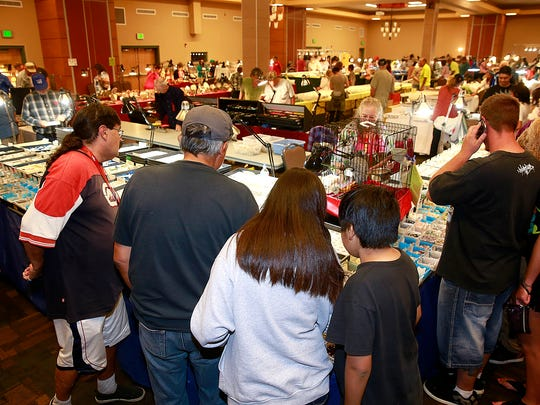 Visitors examine the offerings at the 30th annual San Juan County Gem & Mineral Show Saturday at the Farmington Civic Center.
