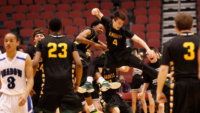 Gilbert Christian celebrates defeating Shadow Mountain during the Division II boys basketball semifinals at Arizona Gila River Arena in Glendale on February 28, 2015.