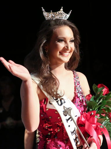 Kayla Knuth waves to the crowd after she was crowned