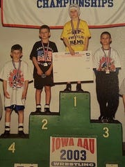 Rivals since childhood, Cory Clark (top) and Thomas Gilman (right) placed first and third in the 50-pound weight class at the 2003 Iowa state AAU tournament.