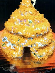 A honey of a cheese ball, this beehive is one example of the motto that Marianne Hacker follows: You can make a cheese ball shaped like anything.