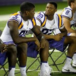 LSU wide receiver D.J. Chark (82) speaks to receiver Tony Upchurch (81) at the LSU Charles McClendon Football Practice Facility in Baton Rouge in 2014.