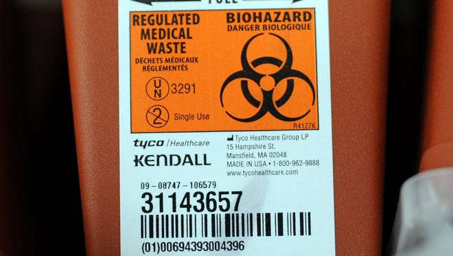 Medical waste containers are stored in April 2015 in Austin, Ind.