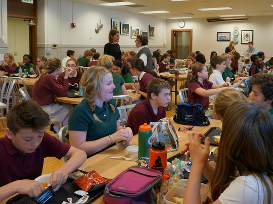 A busy lunchroom at The Oaks Middle School is filled with chatter on May 15, 2016.