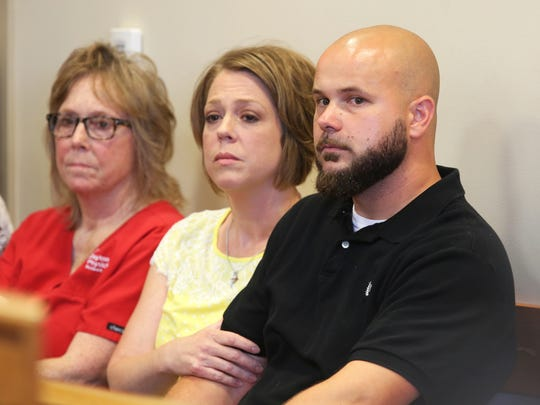 Tommy Hancock and his wife, Sarah, listen to court proceedings as his son is sentenced for the shooting at Madison High School in 2016.
