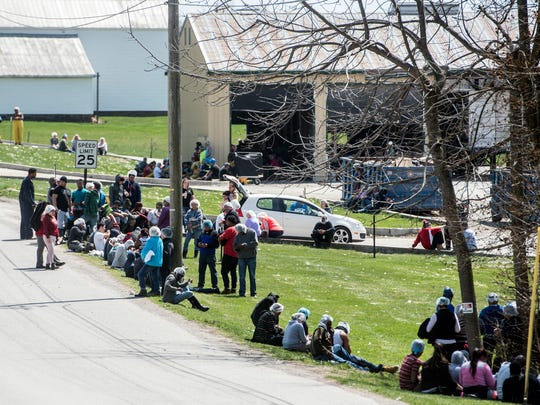 Plainville Farms Plant workers wait outside the plant after being evacuated, Saturday, April 14, 2018. Two employees were taken to Hanover Hospital after inhaling fumes from a hazardous mixture of chemicals.