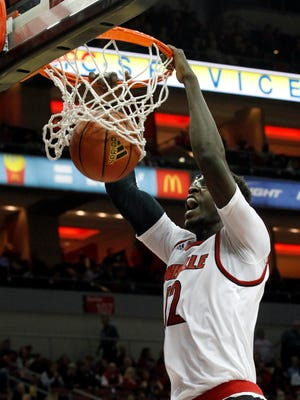 University of Louisville's Mangok Mathiang (12) dunks the ball over top Bellarmine University's defense during the second half of play at the KFC Yum! Center in Louisville, Kentucky.       November 1, 2015