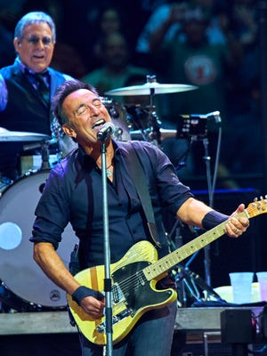 Bruce Springsteen and Max Weinberg, back, perform with the E Street Band on Jan. 27, 2016 at Madison Square Garden in New York.