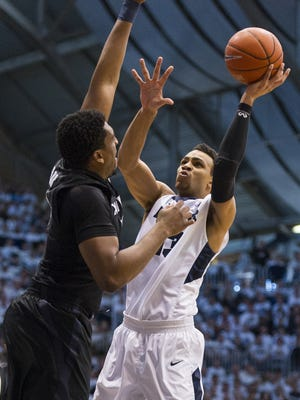 Butler Bulldogs forward Jackson Davis (13) puts up a shot as Xavier Musketeers forward James Farr (2) tries to block during the first half of a NCAA men's basketball game at Butler University's Hinkle Fieldhouse, Saturday, Feb. 13, 2016.