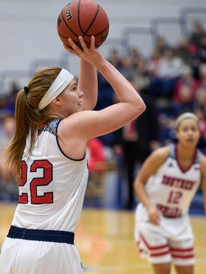 University of Southern Indiana's Morgan Dahlstrom (22) takes a jump shot as the USI Screaming Eagles play the Bellarmine Knights at USI's Physical Activities Center Saturday, February 10, 2018.