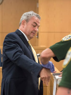 Steven Kunkemoeller is fingerprinted after receiving his sentence at the Escambia County courthouse in Pensacola on Friday, May 18, 2018.  The Ohio businessman has been convicted of helping defraud Florida charter schools out of nearly $1 million in public funding.