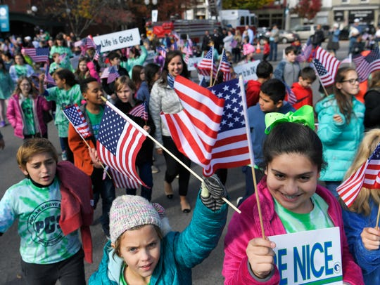 Students from Poplar Grove Elementary School march in the Franklin Veterans  Day Parade in downtown Franklin on November 10, 2017.