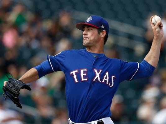 FILE - In this March 8, 2018, file photo, Texas Rangers starting pitcher Cole Hamels throws a pitch against the Chicago White Sox during the fourth inning of a spring training baseball game, in Surprise, Ariz. Hamels will be on the mound Thursday, March 29, in a season opener against Justin Verlander and the Houston Astros. (AP Photo/Ross D. Franklin, File)