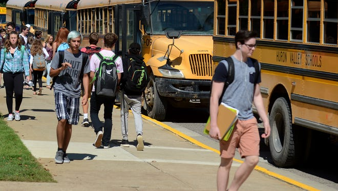 Milford High students head home after school on a recent September afternoon. Huron Valley Schools continues to face serious financial concerns brought on by decreasing enrollment, two failed millage proposals and aging facilities.