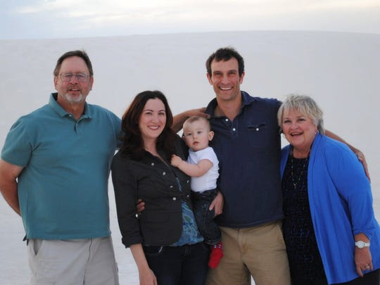 Pat embraces her son, Peter, grandson, Noah, and daughter-in-law, Jenna, and her husband, Fred.