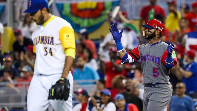 Dominican Republic infielder Jonathan Villar celebrates after hitting a single in the third inning against Colombia during the 2017 World Baseball Classic at Marlins Park.
