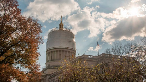 The dome of West Virginia's Capitol will soon lose the protective covering as renovations and repair work conclude.