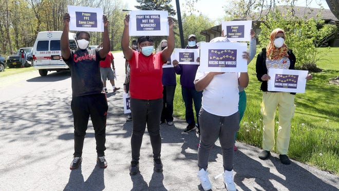 Workers from Creekview Nursing & Rehab Center, gather to protest for more and better protective gear, hazard pay and for New York State to pay for their mandated coronavirus testing they must take each week.
