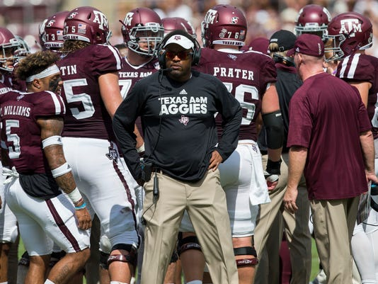 FILE - In this Sept. 16, 2017, file photo, Texas A&M coach Kevin Sumlin waits with his team during a timeout against Louisiana-Lafayette in an NCAA college football game in College Station, Texas. Texas A&M plays Arkansas this week. Arkansas has lost all five of its Southeastern Conference games against the Aggies. (AP Photo/Sam Craft, File)